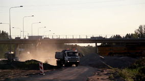Within the site two trucks moving stock footage