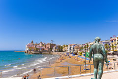 SITGES, CATALUNYA, SPAIN - JUNE 20, 2017: Sculpture of a naked woman on the waterfront. Copy space for text. Royalty Free Stock Image