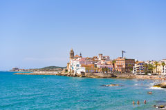 SITGES, CATALUNYA, SPAIN - JUNE 20, 2017: View of the historical center and the church of Sant Bartomeu and Santa Tecla. Copy spac Stock Image