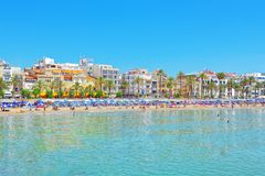 View of the beach and the sea shore of a small resort town Sitge. Sitges, Spain - June 14, 2017 : View of the beach and the sea shore of a small resort town Royalty Free Stock Photography