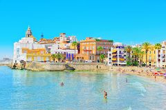 View of the beach and the sea shore of a small resort town Sitge. Sitges, Spain - June 14, 2017 : View of the beach and the sea shore of a small resort town Stock Photos