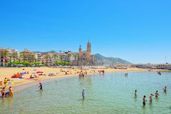 View of the beach and the sea shore of a small resort town Sitge. Sitges, Spain - June 14, 2017 : View of the beach and the sea shore of a small resort town Royalty Free Stock Images