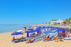 View of the beach and the sea shore of a small resort town Sitge. Sitges, Spain - June 14, 2017 : View of the beach and the sea shore of a small resort town Stock Photography