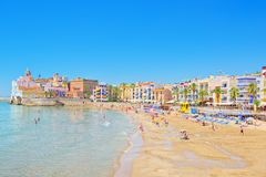 View of the beach and the sea shore of a small resort town Sitge. Sitges, Spain - June 14, 2017 : View of the beach and the sea shore of a small resort town Royalty Free Stock Photo