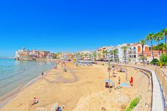 View of the beach and the sea shore of a small resort town Sitge. Sitges, Spain - June 14, 2017 : View of the beach and the sea shore of a small resort town Stock Images