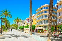 View of the embankment and the promenade in small resort town-Si. Sitges, Spain - June 14, 2017 : View of the embankment and the promenade in small resort town Royalty Free Stock Images