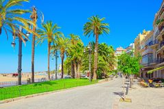View of the embankment and the promenade in small resort town-Si. Sitges, Spain - June 14, 2017 : View of the embankment and the promenade in small resort town Royalty Free Stock Image