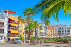 View of the embankment and the promenade in small resort town-Si. Sitges, Spain - June 14, 2017 : View of the embankment and the promenade in small resort town Stock Photo