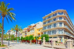 View of the embankment and the promenade in small resort town-Si. Sitges, Spain - June 14, 2017 : View of the embankment and the promenade in small resort town Stock Image