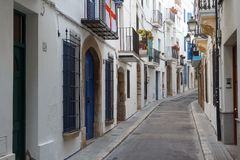 Street in the historic centre. SITGES / SPAIN - SEPTEMBER 2014: Street in the historic centre of Sitges town, Spain Royalty Free Stock Images