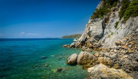 Sithonia coast. Greece Mediterranean coast with cliff and turquoise sea landscape Stock Image