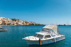 Seaport of Sitia town with moored traditional Greek fishing boats Stock Photo