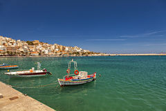 Sitia Crete. Small fishing boats in crystal clear waters. Sitia, Crete Stock Images