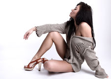 Siting beautiful brunette in a woollen sweater stock photography