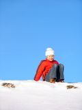 Siting on snow Stock Photography
