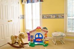 Sitio acogedor del bebé con los juguetes Fotos de archivo libres de regalías