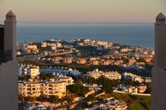 Sitio de Calahonda at sunset. Hilltop view of the Sitio de Calahonda Costa del Sol between two apartment pillars at sunset Stock Photo