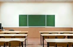 Sitio de clase con una tarjeta de escuela Fotografía de archivo