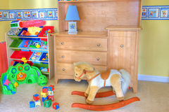 Sitio del bebé con los juguetes Fotografía de archivo