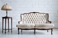 Sitio del sofá de la vendimia Foto de archivo