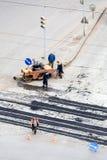 Sitio, piedras, grava y asfalto de la construcción de carreteras Foto de archivo libre de regalías