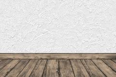 Sitio vacío con la pared blanca y el suelo de madera Fotos de archivo