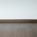 Sitio vacío interior, piso marrón de la lamina de madera fotos de archivo libres de regalías
