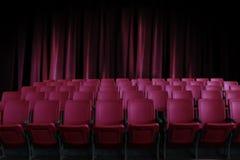 Sitios vacíos en el cine con la cortina roja vieja Foto de archivo libre de regalías