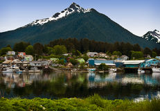 Sitka, Alaska. Houses, buildings, boats and a float plane reflected on the water of Sitka, Alaska, an island community on the inside passage of coastal Alaska