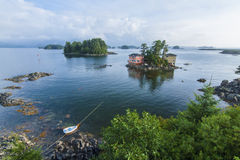 Sitka, Alaska. Beautiful calm summer, seascape with boat and houses on tiny forested islands in Sitka Sound on Baranof Island, Alaska Stock Photography