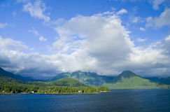 Sitka Alaska Coast View. Blue sky and clouds over the coast of Sitka Alaska in the Inside Passage Royalty Free Stock Photography