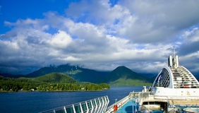 Sitka Alaska Cruise ship View. Blue sky and clouds over the coast of Sitka Alaska in the Inside Passage from a cruise ship Stock Photography