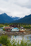 Sitka Bay. Houses by Marina with snowed capped mountains in the background at Sitka, Alaska Stock Photo