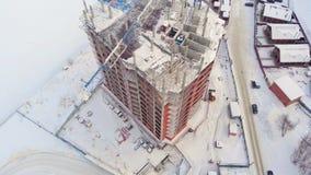 Sito di edificio residenziale, inverno, vista aerea, tiro dell'elicottero stock footage