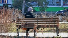 Sits on a bench grandmother in an old woman park. Sits on bench grandmother in an old woman park Royalty Free Stock Photography