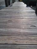 Sitta på en skeppsdocka vid floden Fotografering för Bildbyråer
