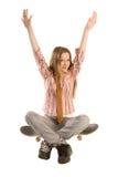 Sitta på skateboarden Royaltyfria Bilder