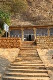 Sittanavasal cave temple with beautiful rock hill. Royalty Free Stock Photo