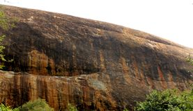 A single rock of sittanavasal cave temple complex. Sittanavasal is a small hamlet in Pudukkottai district of Tamil Nadu, India. It is known for the Sittanavasal Stock Photography