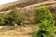 Sittanavasal cave temple with beautiful rock hill. Stock Photography