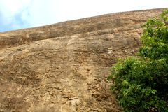 A hill surface with sky of sittanavasal cave temple complex. Sittanavasal is a small hamlet in Pudukkottai district of Tamil Nadu, India. It is known for the Royalty Free Stock Photos