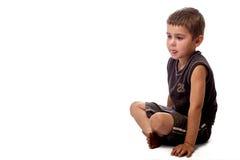 sittande barn för pojke Arkivfoton