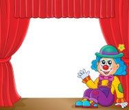 Sittande clowntemabild 2 Arkivbild
