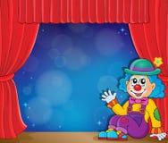 Sittande clowntemabild 3 Arkivbild