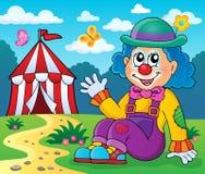 Sittande clowntemabild 4 Arkivbild