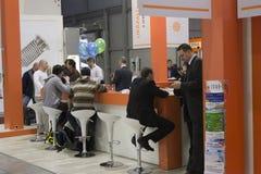 Sittande folk på AquaTherm 2011 i Prague Fotografering för Bildbyråer