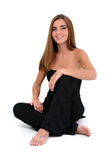 sittande kvinnabarn för härligt golv Arkivbild