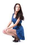 sittande slankt kvinnabarn Royaltyfria Bilder