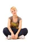 sittande smiley för flicka Royaltyfri Foto