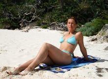 sittande sunbath Arkivfoto